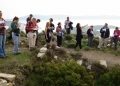 Regular Member Maggie Beeler points out features around the Bronze Age tombs at Thorikos.