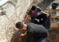 Conservation technician interns excavating medieval skeletons in the Frankish Area.