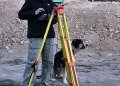 Janelle Sadarananda and her assistant, Roger, at the total station entering information into iDig.