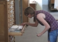Heather Graybehl completing the shelf inventories